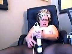 Mature woman enjoying her wand