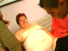 Big grandma challanges two young guys..
