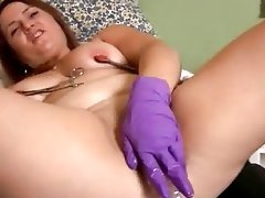 Chubby redhead fingers her asshole