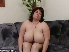 Busty and mature bbw masturbates with..