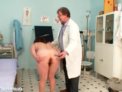 Gloved hands doctor examines mature..