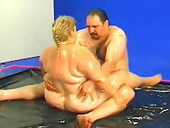 Fat couple oil wrestling and kinky play