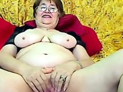 Fat grandmother with glasses masturbates