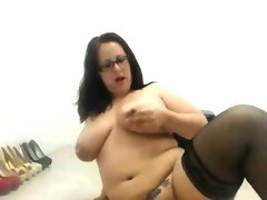 Bbw in glasses riding a toy in front..